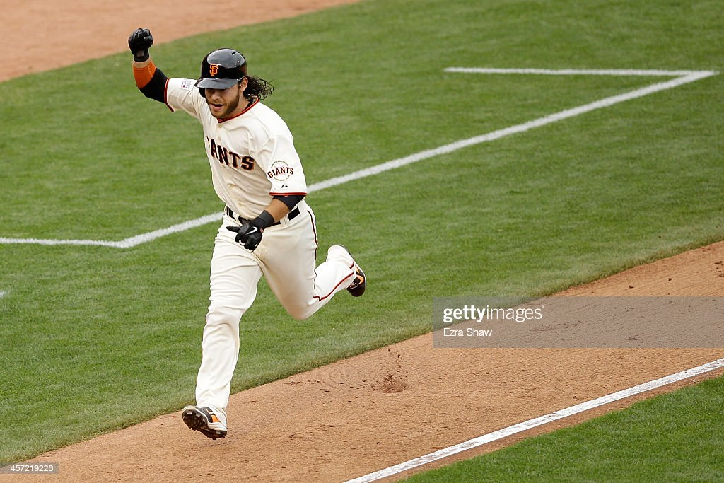 <a gi-track='captionPersonalityLinkClicked' href=/galleries/search?phrase=Brandon+Crawford&family=editorial&specificpeople=5580312 ng-click='$event.stopPropagation()'>Brandon Crawford</a> #35 of the San Francisco Giants celebrates in the 10th inning before he scores the game-winning run against the St. Louis Cardinals during Game Three of the National League Championship Series at AT&T Park on October 14, 2014 in San Francisco, California.