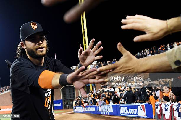 Brandon Crawford of the San Francisco Giants celebrates their 3 to 2 win over the Washington Nationals in Game Four of the National League Division...