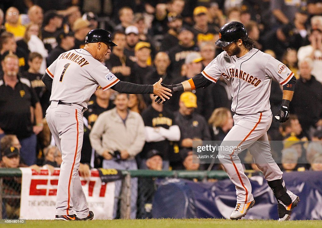 <a gi-track='captionPersonalityLinkClicked' href=/galleries/search?phrase=Brandon+Crawford&family=editorial&specificpeople=5580312 ng-click='$event.stopPropagation()'>Brandon Crawford</a> #35 of the San Francisco Giants celebrates with third base coach <a gi-track='captionPersonalityLinkClicked' href=/galleries/search?phrase=Tim+Flannery&family=editorial&specificpeople=691944 ng-click='$event.stopPropagation()'>Tim Flannery</a> #1 as he rounds the bases after hitting a four-run home run in the fourth inning against the Pittsburgh Pirates during the National League Wild Card game at PNC Park on October 1, 2014 in Pittsburgh, Pennsylvania.