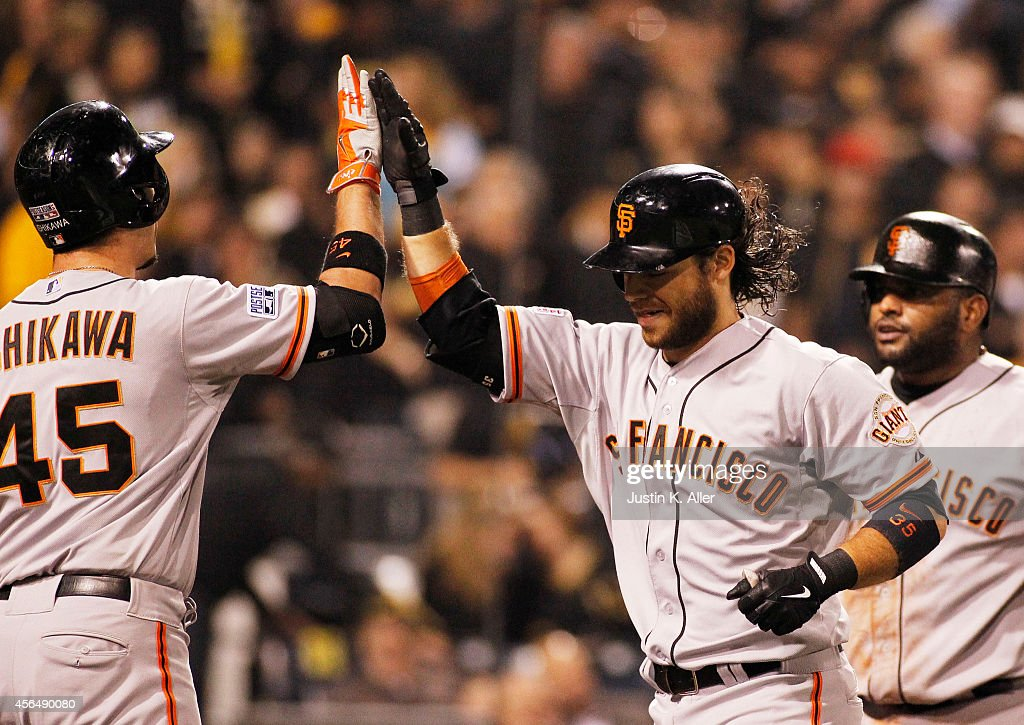 <a gi-track='captionPersonalityLinkClicked' href=/galleries/search?phrase=Brandon+Crawford&family=editorial&specificpeople=5580312 ng-click='$event.stopPropagation()'>Brandon Crawford</a> #35 of the San Francisco Giants celebrates with <a gi-track='captionPersonalityLinkClicked' href=/galleries/search?phrase=Travis+Ishikawa&family=editorial&specificpeople=551505 ng-click='$event.stopPropagation()'>Travis Ishikawa</a> #45 after hitting a four-run home run in the fourth inning against the Pittsburgh Pirates during the National League Wild Card game at PNC Park on October 1, 2014 in Pittsburgh, Pennsylvania.