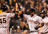 Brandon Crawford of the San Francisco Giants celebrates with Travis Ishikawa after hitting a fourrun home run in the fourth inning against the...