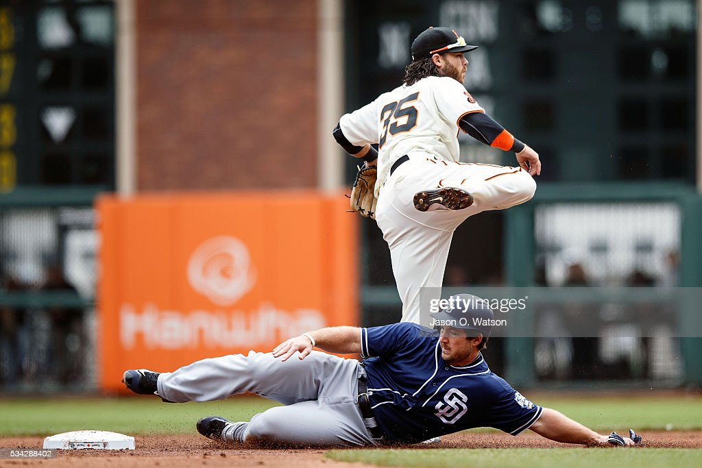 <a gi-track='captionPersonalityLinkClicked' href=/galleries/search?phrase=Brandon+Crawford&family=editorial&specificpeople=5580312 ng-click='$event.stopPropagation()'>Brandon Crawford</a> #35 of the San Francisco Giants completes a double play over <a gi-track='captionPersonalityLinkClicked' href=/galleries/search?phrase=Brett+Wallace&family=editorial&specificpeople=2364861 ng-click='$event.stopPropagation()'>Brett Wallace</a> #39 of the San Diego Padres during the second inning at AT&T Park on May 25, 2016 in San Francisco, California.