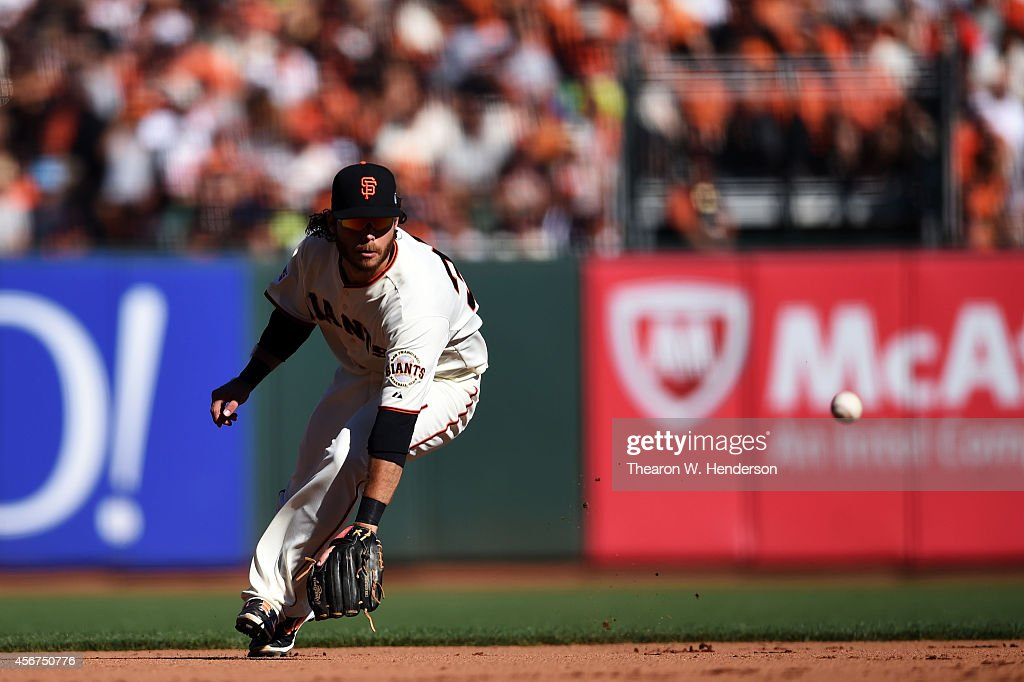 <a gi-track='captionPersonalityLinkClicked' href=/galleries/search?phrase=Brandon+Crawford&family=editorial&specificpeople=5580312 ng-click='$event.stopPropagation()'>Brandon Crawford</a> #35 of the San Francisco Giants fields a ball hit by Wilson Ramos #40 of the Washington Nationals for an out in the fifth inning during Game Three of the National League Division Series at AT&T Park on October 6, 2014 in San Francisco, California.