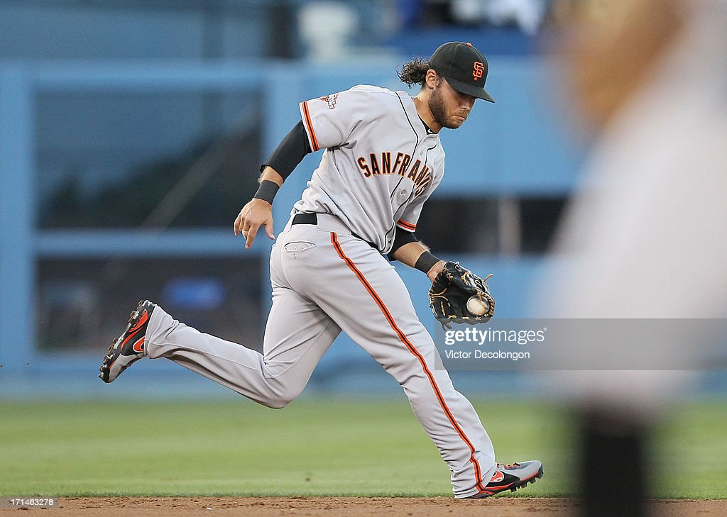 <a gi-track='captionPersonalityLinkClicked' href=/galleries/search?phrase=Brandon+Crawford&family=editorial&specificpeople=5580312 ng-click='$event.stopPropagation()'>Brandon Crawford</a> #35 of the San Francisco Giants fields a ground ball hit by Jerry Hairston Jr. #6 of the Los Angeles Dodgers (not in photo) in the second inning during the MLB game at Dodger Stadium on June 24, 2013 in Los Angeles, California.