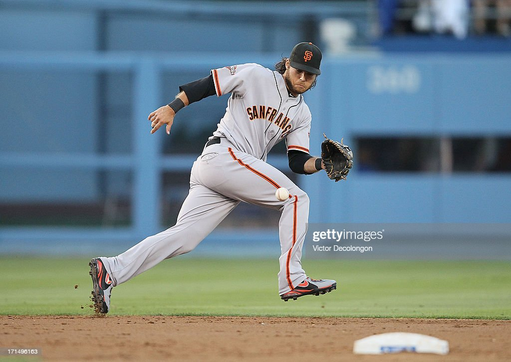 <a gi-track='captionPersonalityLinkClicked' href=/galleries/search?phrase=Brandon+Crawford&family=editorial&specificpeople=5580312 ng-click='$event.stopPropagation()'>Brandon Crawford</a> #35 of the San Francisco Giants fields a ground ball hit by Jerry Hairston Jr. #6 of the Los Angeles Dodgers (not in photo) in the second inning during the MLB game at Dodger Stadium on June 24, 2013 in Los Angeles, California. The Dodgers defeated the Giants 3-1.
