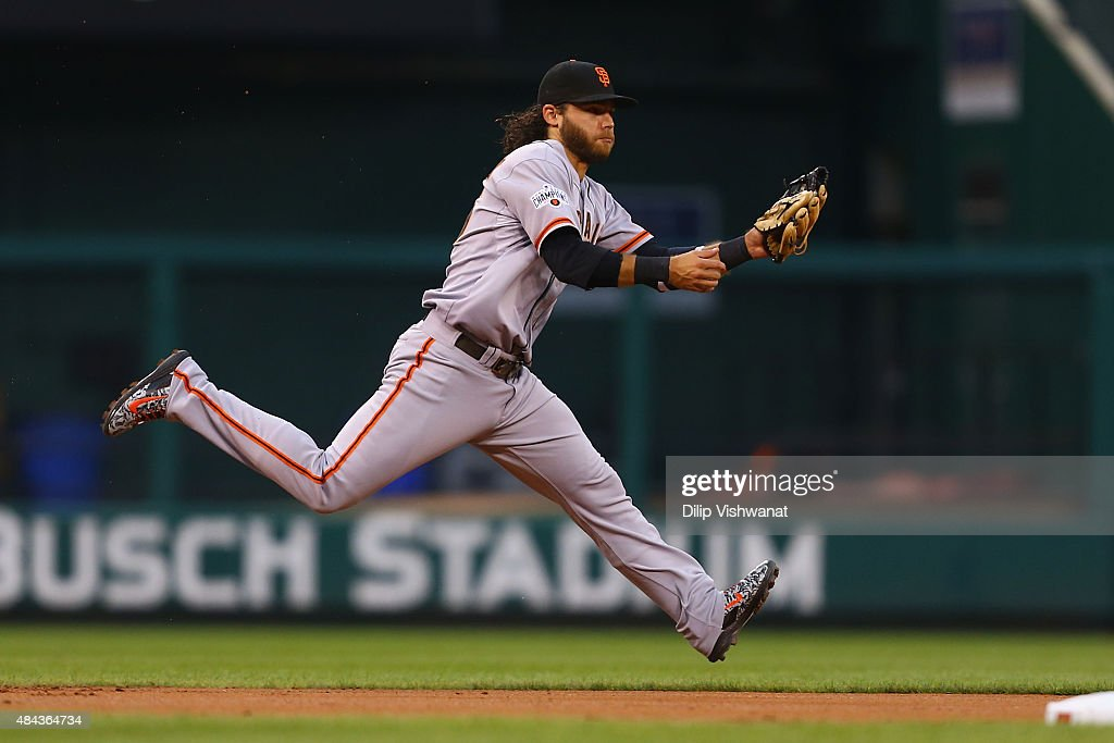Brandon Crawford #35 of the San Francisco Giants fields a ground ball against the St. Louis Cardinals in the first inning at Busch Stadium on August 17, 2015 in St. Louis, Missouri.