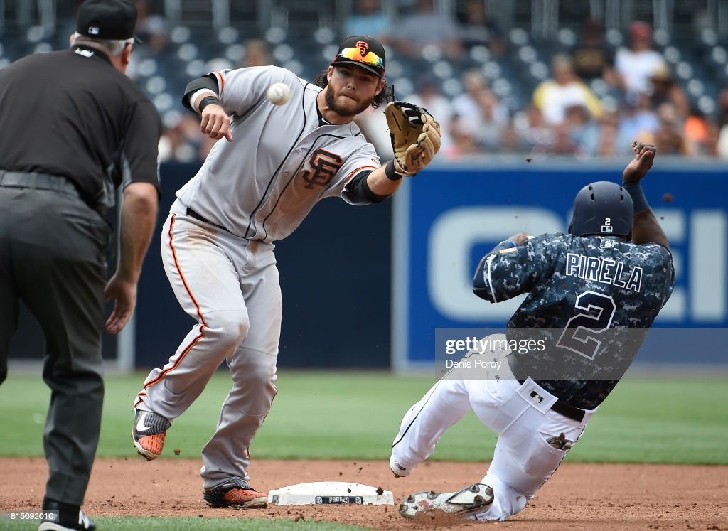 Brandon Crawford #35 of the San Francisco Giants fields the ball as Jose Pirela #2 of the San Diego Padres tries to steal second base during the second inning of a baseball game at PETCO Park on July 16, 2017 in San Diego, California. Pirelli was tagged out on the play.