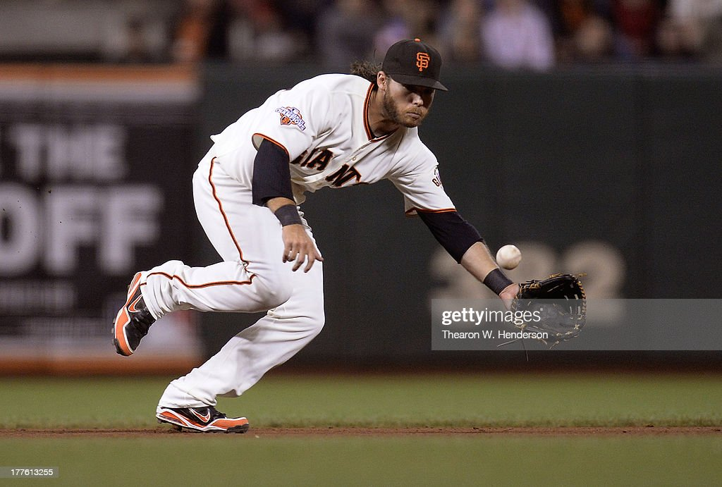 <a gi-track='captionPersonalityLinkClicked' href=/galleries/search?phrase=Brandon+Crawford&family=editorial&specificpeople=5580312 ng-click='$event.stopPropagation()'>Brandon Crawford</a> #35 of the San Francisco Giants goes up the middle to take a hit away from Gaby Sanchez #14 of the Pittsburgh Pirates in the eighth inning at AT&T Park on August 24, 2013 in San Francisco, California.