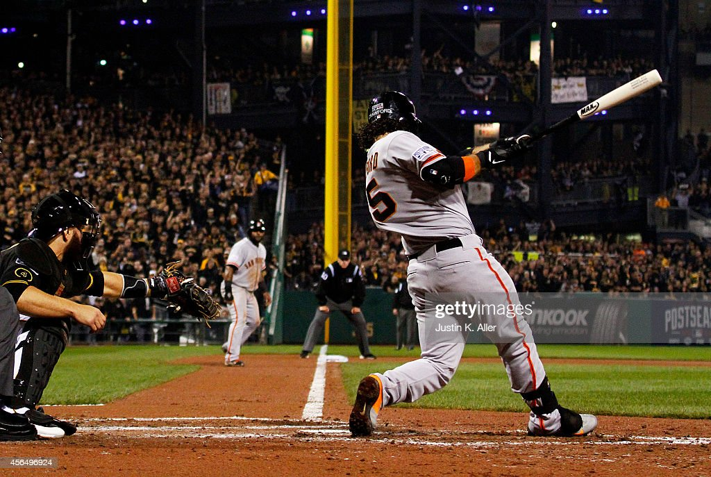 <a gi-track='captionPersonalityLinkClicked' href=/galleries/search?phrase=Brandon+Crawford&family=editorial&specificpeople=5580312 ng-click='$event.stopPropagation()'>Brandon Crawford</a> #35 of the San Francisco Giants hits a four-run home run in the fourth inning against the Pittsburgh Pirates during the National League Wild Card game at PNC Park on October 1, 2014 in Pittsburgh, Pennsylvania.
