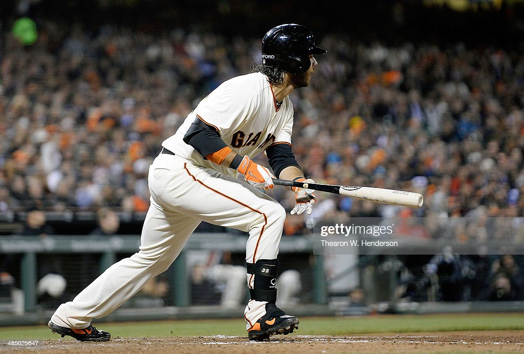 <a gi-track='captionPersonalityLinkClicked' href=/galleries/search?phrase=Brandon+Crawford&family=editorial&specificpeople=5580312 ng-click='$event.stopPropagation()'>Brandon Crawford</a> of the San Francisco Giants hits a sacrifice fly scoring Hunter Pence (not pictured) against the Los Angeles Dodgers in the bottom of the six inning at AT&T Park on April 15, 2014 in San Francisco, California. All uniformed team members are wearing jersey number 42 in honor of Jackie Robinson Day.