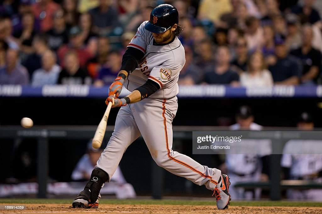 <a gi-track='captionPersonalityLinkClicked' href=/galleries/search?phrase=Brandon+Crawford&family=editorial&specificpeople=5580312 ng-click='$event.stopPropagation()'>Brandon Crawford</a> #35 of the San Francisco Giants hits a three run double during the fourth inning against the Colorado Rockies at Coors Field on May 16, 2013 in Denver, Colorado. The Giants defeated the Rockies 8-6.
