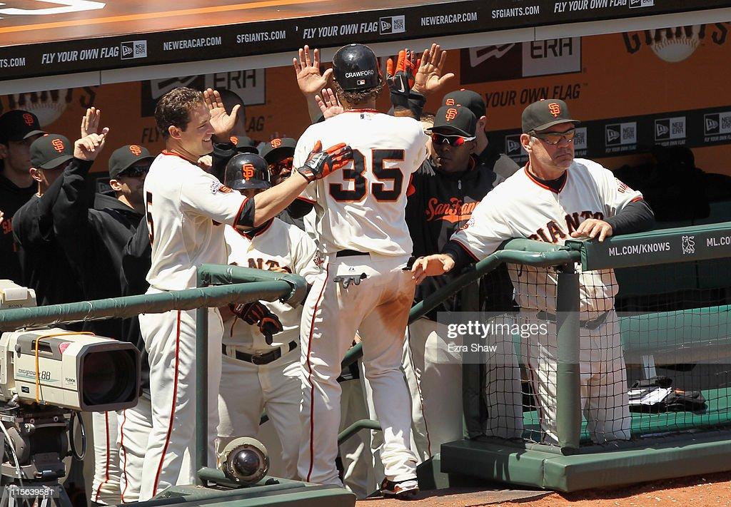 Brandon Crawford #35 of the San Francisco Giants is congratulated be teammates after he scored in the seventh inning against the Washington Nationals at AT&T Park on June 8, 2011 in San Francisco, California.