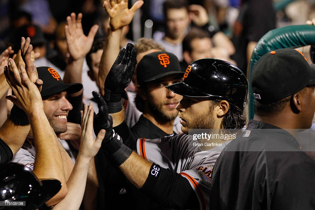 <a gi-track='captionPersonalityLinkClicked' href=/galleries/search?phrase=Brandon+Crawford&family=editorial&specificpeople=5580312 ng-click='$event.stopPropagation()'>Brandon Crawford</a> #35 of the San Francisco Giants is congratulated by teammates in the dugout after hitting a solo home run in the seventh inning of the game against the Philadelphia Phillies at Citizens Bank Park on July 31, 2013 in Philadelphia, Pennsylvania.The Giants won 9-2.