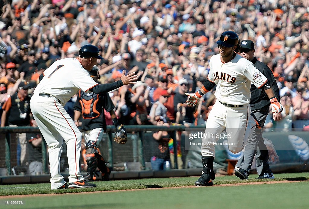 Brandon Crawford #35 of the San Francisco Giants is congratulated by third base coach Tim Fannery after hitting a walk-off solo home run against the Colorado Rockies in the bottom of the tenth inning at AT&T Park on April 13, 2014 in San Francisco, California. The Giants won the game 5-4.