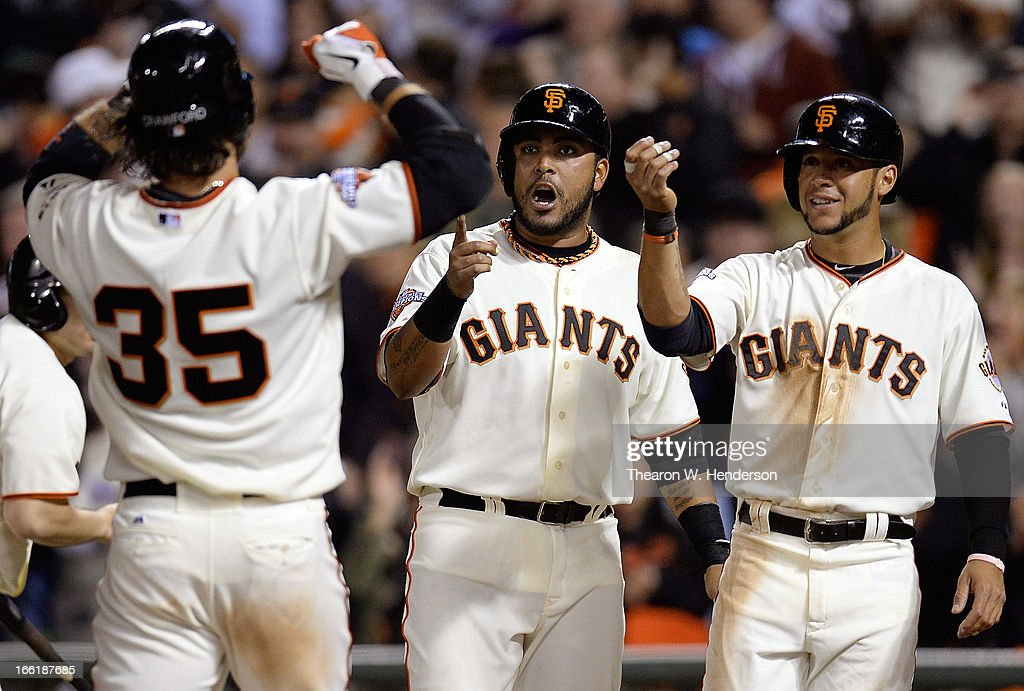<a gi-track='captionPersonalityLinkClicked' href=/galleries/search?phrase=Brandon+Crawford&family=editorial&specificpeople=5580312 ng-click='$event.stopPropagation()'>Brandon Crawford</a> #35 of the San Francisco Giants is greated at home plate by <a gi-track='captionPersonalityLinkClicked' href=/galleries/search?phrase=Gregor+Blanco&family=editorial&specificpeople=4137600 ng-click='$event.stopPropagation()'>Gregor Blanco</a> (R) and Hector Sanchez (L), both who scored on Crawfords three-run home run against the Colorado Rockies in the six inning at AT&T Park on April 9, 2013 in San Francisco, California.