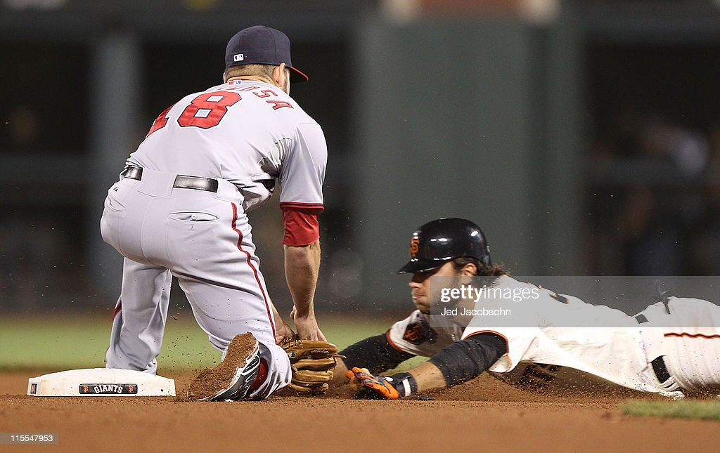 Brandon Crawford #35 of the San Francisco Giants is tagged out on a steal attempt in the seventh inning as Danny Espinosa #18 of the Washington Nationals applies the tag during an MLB game at AT&T Park on June 7, 2011 in San Francisco, California.