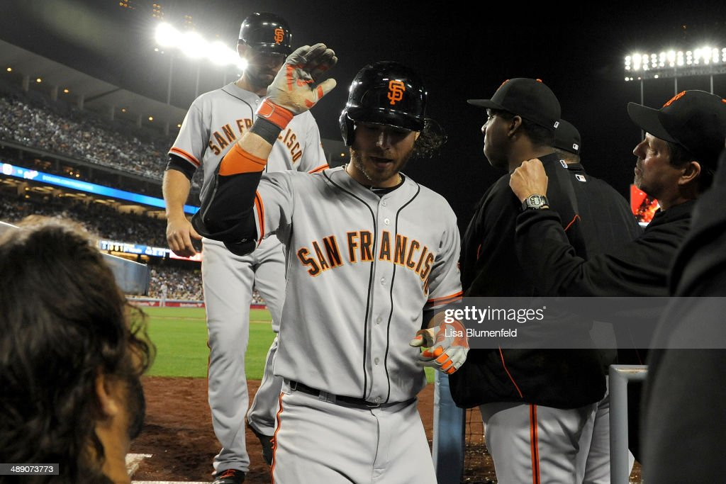 <a gi-track='captionPersonalityLinkClicked' href=/galleries/search?phrase=Brandon+Crawford&family=editorial&specificpeople=5580312 ng-click='$event.stopPropagation()'>Brandon Crawford</a> #35 of the San Francisco Giants returns to the dugout after hitting a two run homerun in the fifth against the Los Angeles Dodgers at Dodger Stadium on May 9, 2014 in Los Angeles, California.