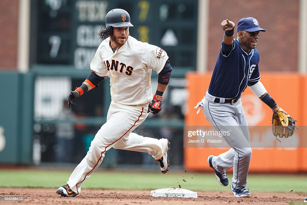 <a gi-track='captionPersonalityLinkClicked' href=/galleries/search?phrase=Brandon+Crawford&family=editorial&specificpeople=5580312 ng-click='$event.stopPropagation()'>Brandon Crawford</a> #35 of the San Francisco Giants rounds second base past <a gi-track='captionPersonalityLinkClicked' href=/galleries/search?phrase=Alexei+Ramirez&family=editorial&specificpeople=690568 ng-click='$event.stopPropagation()'>Alexei Ramirez</a> #10 of the San Diego Padres during the second inning at AT&T Park on May 25, 2016 in San Francisco, California.