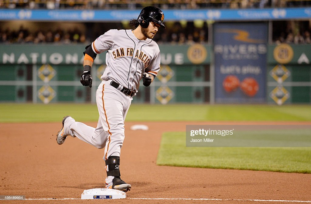 <a gi-track='captionPersonalityLinkClicked' href=/galleries/search?phrase=Brandon+Crawford&family=editorial&specificpeople=5580312 ng-click='$event.stopPropagation()'>Brandon Crawford</a> #35 of the San Francisco Giants rounds the bases after hitting a four-run home run in the fourth inning against the Pittsburgh Pirates during the National League Wild Card game at PNC Park on October 1, 2014 in Pittsburgh, Pennsylvania.