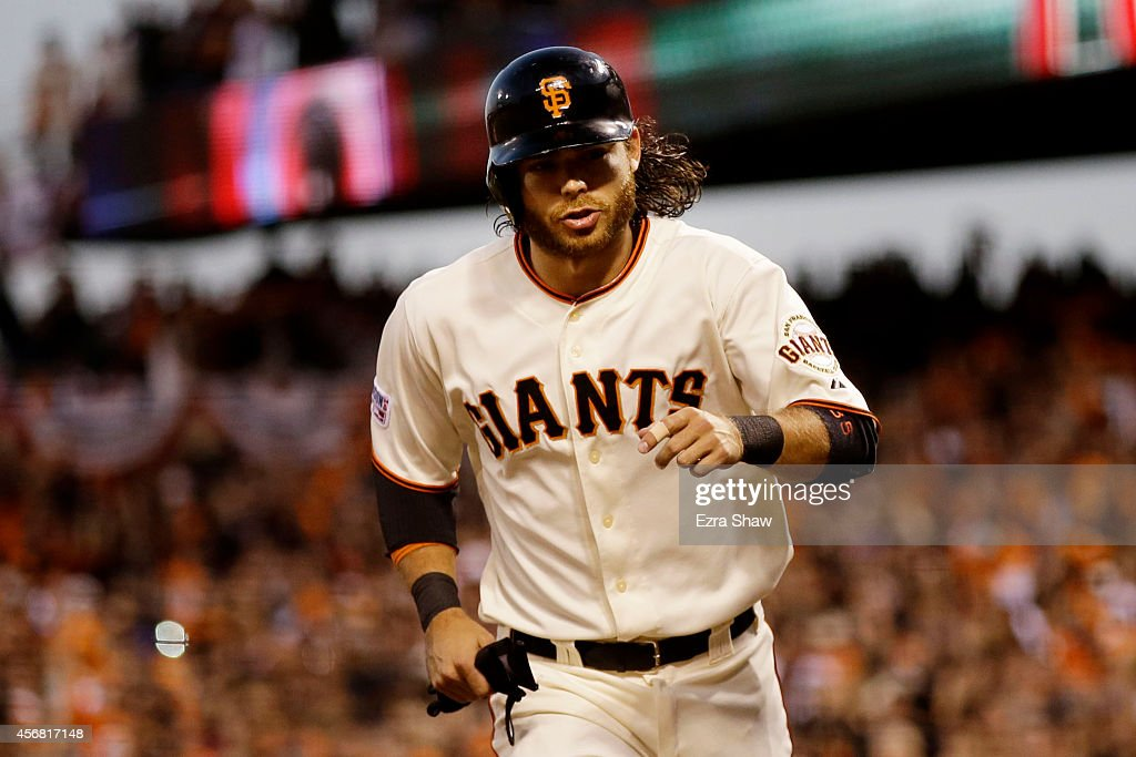 <a gi-track='captionPersonalityLinkClicked' href=/galleries/search?phrase=Brandon+Crawford&family=editorial&specificpeople=5580312 ng-click='$event.stopPropagation()'>Brandon Crawford</a> #35 of the San Francisco Giants scores after Gregor Blanco #7 was walked in the second inning against the Washington Nationals during Game Four of the National League Division Series at AT&T Park on October 7, 2014 in San Francisco, California.