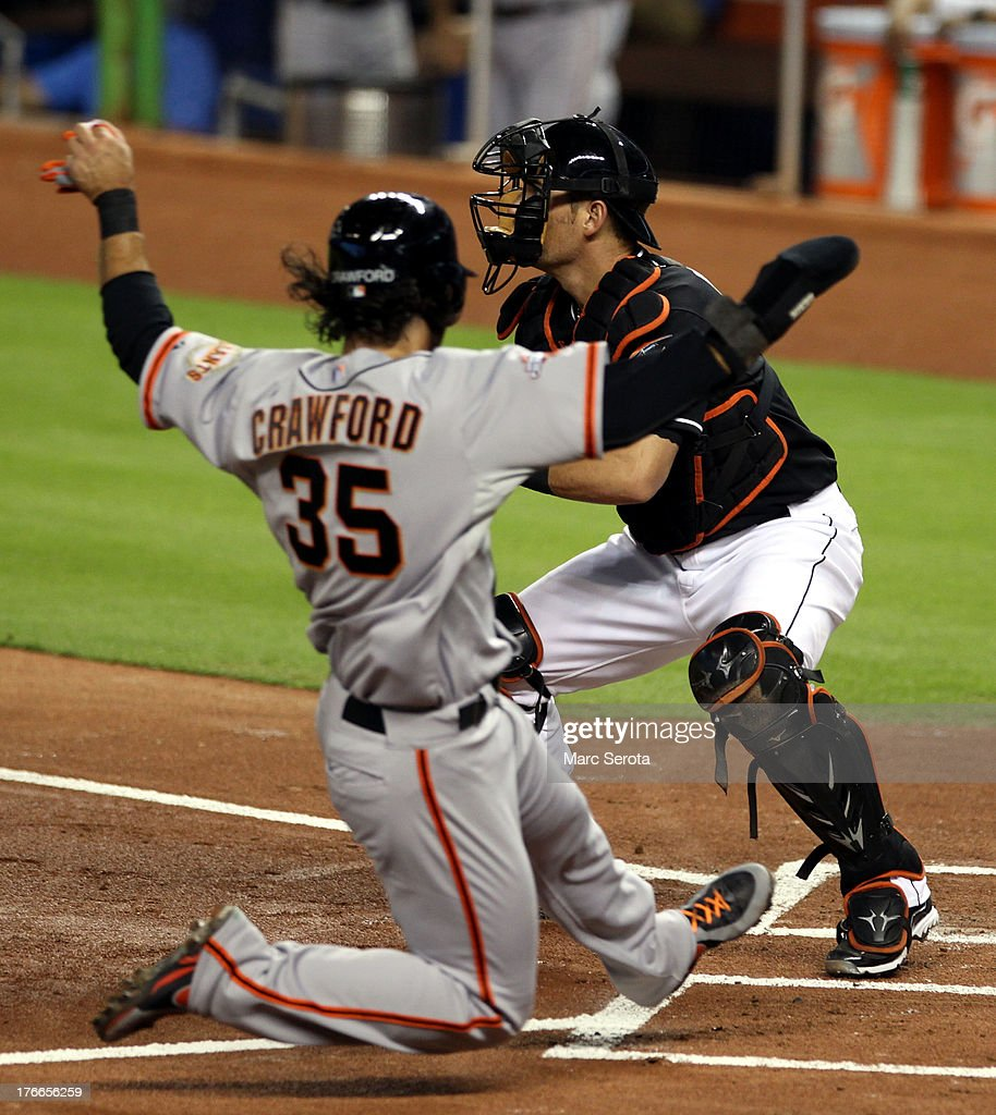 <a gi-track='captionPersonalityLinkClicked' href=/galleries/search?phrase=Brandon+Crawford&family=editorial&specificpeople=5580312 ng-click='$event.stopPropagation()'>Brandon Crawford</a> #35 of the San Francisco Giants scores against the Miami Marlins during the first inning at Marlins Park on August 16, 2013 in Miami, Florida.