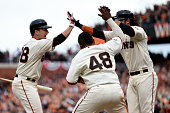 Brandon Crawford of the San Francisco Giants scores the gamewinning run and celebrates with Pablo Sandoval and Buster Posey as the Giants defeat the...