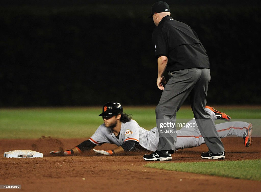 <a gi-track='captionPersonalityLinkClicked' href=/galleries/search?phrase=Brandon+Crawford&family=editorial&specificpeople=5580312 ng-click='$event.stopPropagation()'>Brandon Crawford</a> #35 of the San Francisco Giants slides safely with a double against the Chicago Cubs during the third inning on August 20, 2014 at Wrigley Field in Chicago, Illinois.