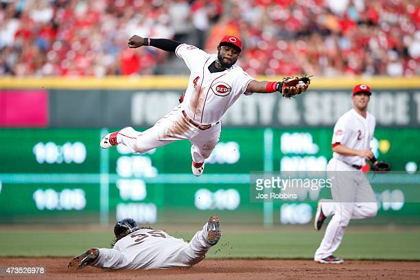 Brandon Crawford of the San Francisco Giants steals second base ahead of the throw to Brandon Phillips of the Cincinnati Reds in the second inning of...