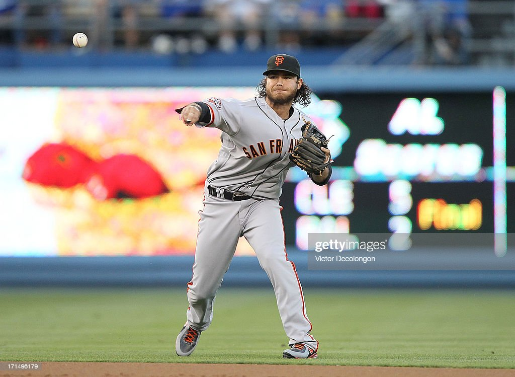 <a gi-track='captionPersonalityLinkClicked' href=/galleries/search?phrase=Brandon+Crawford&family=editorial&specificpeople=5580312 ng-click='$event.stopPropagation()'>Brandon Crawford</a> #35 of the San Francisco Giants throws to first base on a ground ball hit by Jerry Hairston Jr. #6 of the Los Angeles Dodgers (not in photo) in the second inning during the MLB game at Dodger Stadium on June 24, 2013 in Los Angeles, California. The Dodgers defeated the Giants 3-1.
