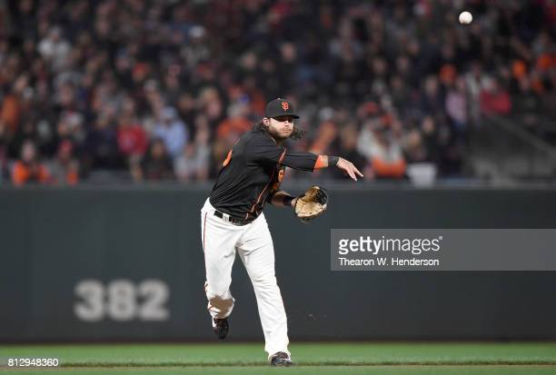 Brandon Crawford of the San Francisco Giants throws to first base throwing out JT Realmuto of the Miami Marlins in the top of the eighth inning at...