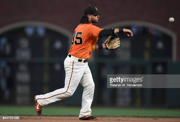 Brandon Crawford of the San Francisco Giants throws to first base throwing out Stephen Piscotty of the St Louis Cardinals in the top of the second...