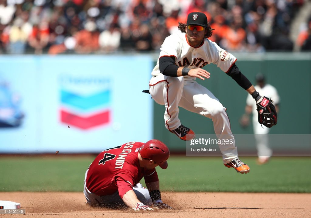 Brandon Crawford of the San Francisco Giants turns a double play getting Paul Goldschmidt of the Arizona Diamondbacks out as the San Francisco Giants...
