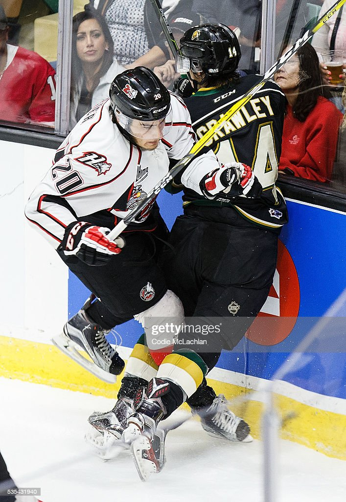 Brandon Crawley #14 of the London Knights (OHL) collides with <a gi-track='captionPersonalityLinkClicked' href=/galleries/search?phrase=Timo+Meier&family=editorial&specificpeople=13676883 ng-click='$event.stopPropagation()'>Timo Meier</a> #20 of the Rouyn-Noranda Huskies (QMJHL) during the Memorial Cup Final on May 29, 2016 at the Enmax Centrium in Red Deer, Alberta, Canada.