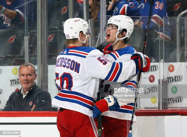 Brandon Crawley of the New York Rangers celebrates his powerplay goal at 255 of the third period against the New Jersey Devils and is joined by Lias...