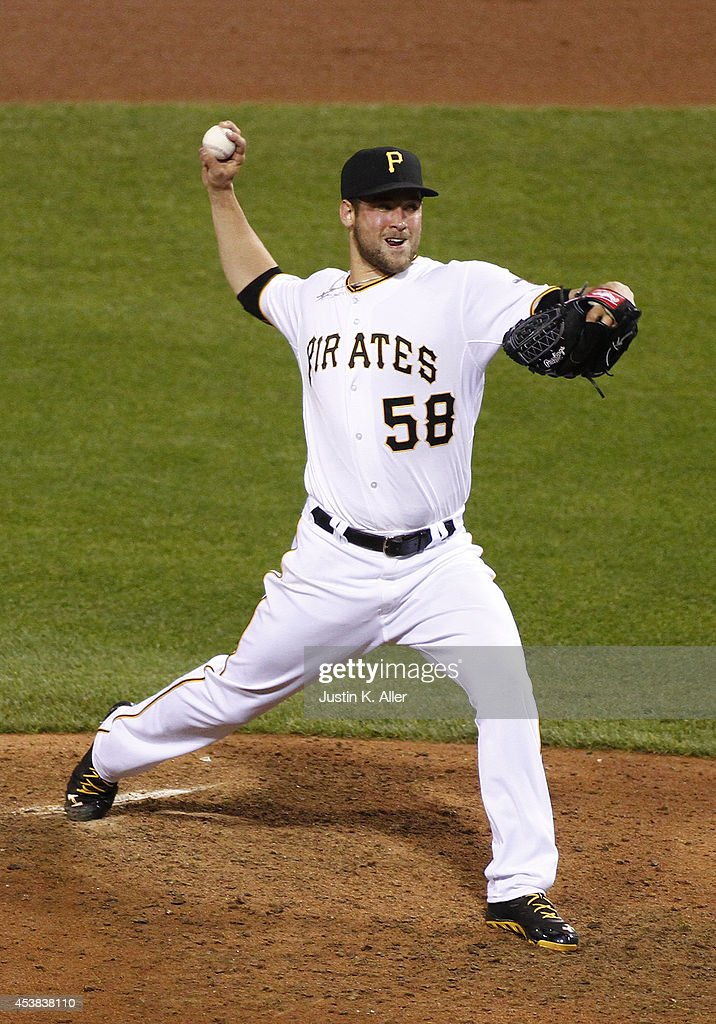 Brandon Cumpton #58 of the Pittsburgh Pirates pitches in the ninth inning against the Atlanta Braves during the game at PNC Park on August 19, 2014 in Pittsburgh, Pennsylvania.