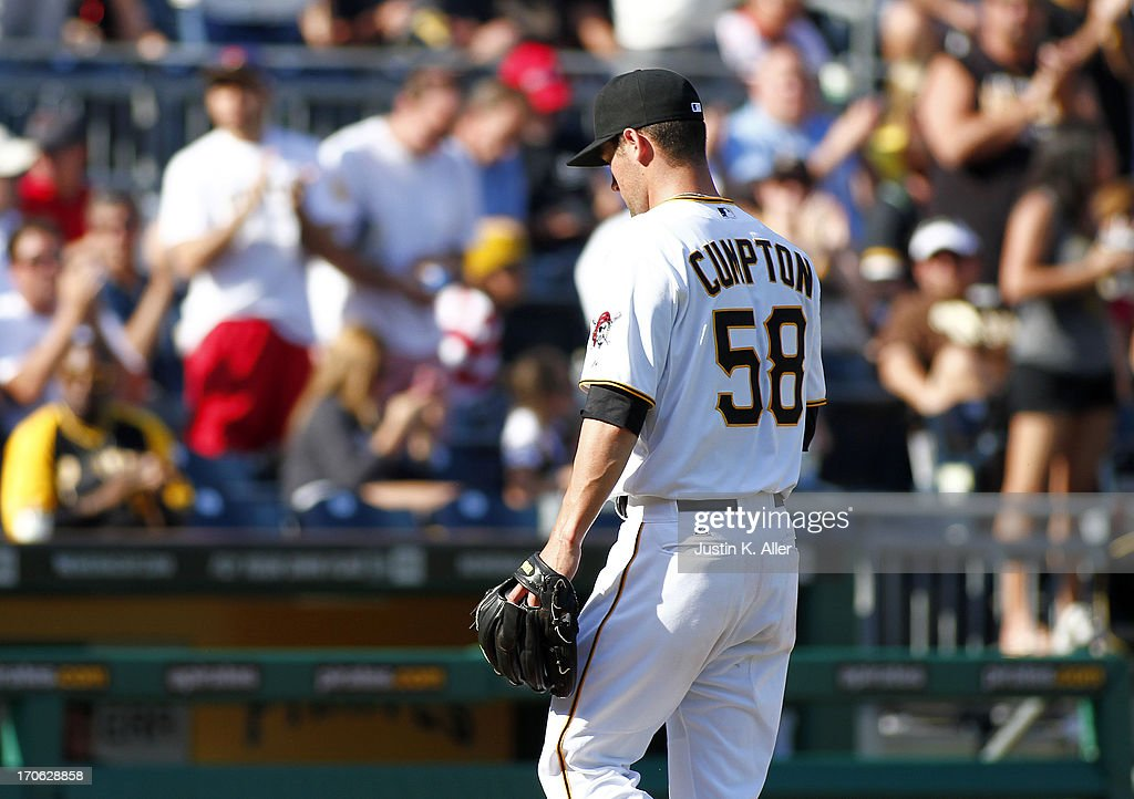 Brandon Cumpton #58 of the Pittsburgh Pirates walks off the field after being removed from the game in the sixth inning after giving up seven hits and 3 earned runs against the Los Angeles Dodgers during the game on June 15, 2013 at PNC Park in Pittsburgh, Pennsylvania.