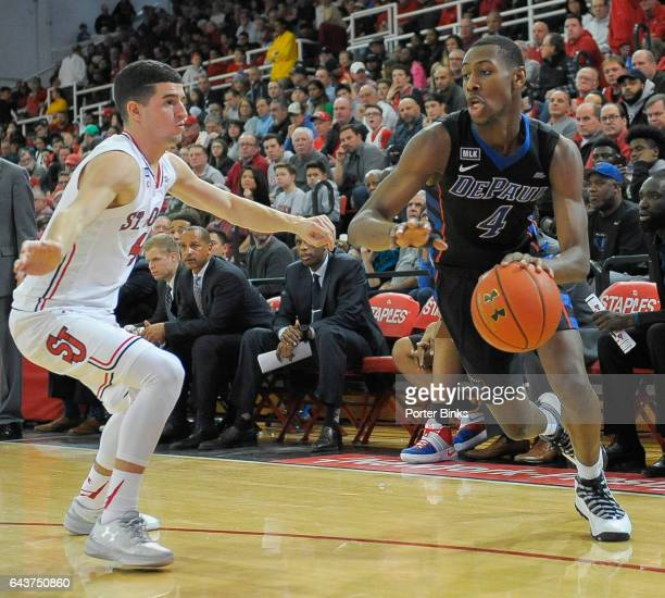 Brandon Cyrus of the DePaul Blue Demons dribbles against Federico Mussini of the St John's Red Storm during a game at Carnesecca Arena on January 16...