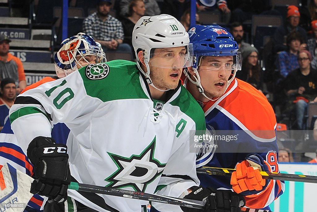 Brandon Davidson of the Edmonton Oilers battles for position against Shawn Horcoff of the Dallas Stars on March 27 2015 at Rexall Place in Edmonton...