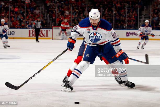 Brandon Davidson of the Edmonton Oilers skates for possession against the Florida Panthers at the BBT Center on February 22 2017 in Sunrise Florida