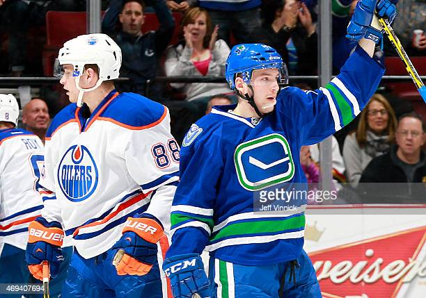 Brandon Davidson of the Edmonton Oilers turns away as Sven Baertschi of the Vancouver Canucks celebrates his goal during their NHL game at Rogers...