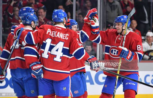 Brandon Davidson of the Montreal Canadiens celebrates after scoring a goal against the Florida Panthers in the NHL game at the Bell Centre on March...