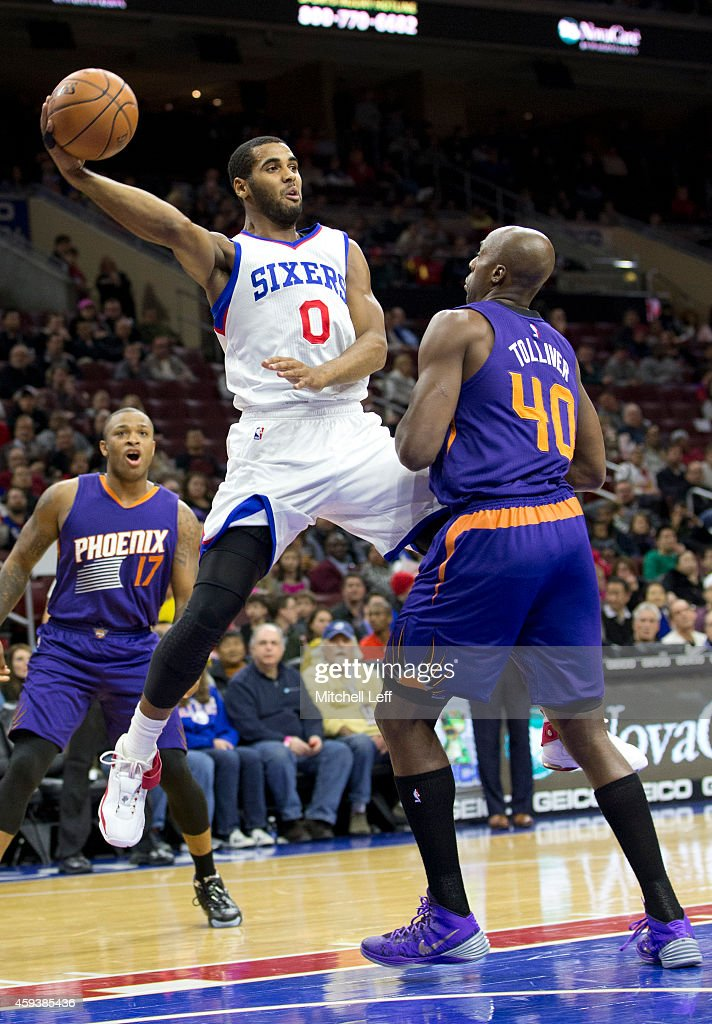Brandon Davies of the Philadelphia 76ers attempts to pass the ball with Anthony Tolliver of the Phoenix Suns defending on the play on November 21...