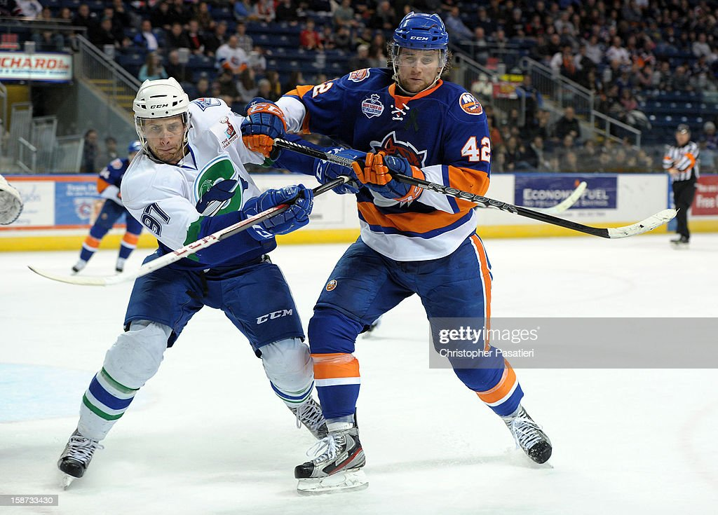 Brandon DeFazio #42 of the Bridgeport Sound Tigers checks <a gi-track='captionPersonalityLinkClicked' href=/galleries/search?phrase=Matt+Gilroy&family=editorial&specificpeople=817917 ng-click='$event.stopPropagation()'>Matt Gilroy</a> #97 of the Connecticut Whale during an American Hockey League game against the Connecticut Whale on December 26, 2012 at the Webster Bank Arena at Harbor Yard in Bridgeport, Connecticut.