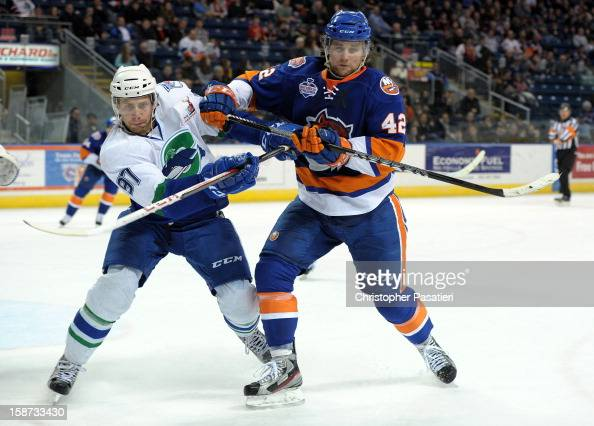 Brandon DeFazio of the Bridgeport Sound Tigers checks Matt Gilroy of the Connecticut Whale during an American Hockey League game against the...