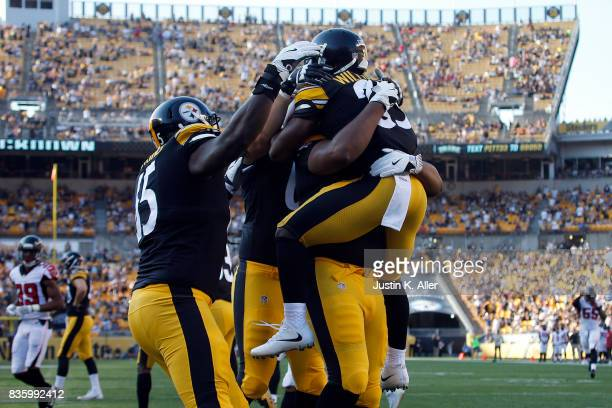 Brandon Dixon of the Pittsburgh Steelers celebrates with teammates after returning a punt 64 yards for a touchdown in the second half against the...