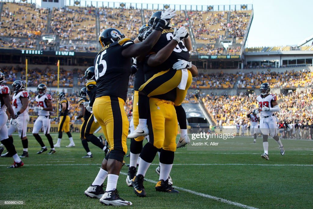 Brandon Dixon #35 of the Pittsburgh Steelers celebrates with teammates after returning a punt 64 yards for a touchdown in the second half against the Atlanta Falcons during a preseason game at Heinz Field on August 20, 2017 in Pittsburgh, Pennsylvania.