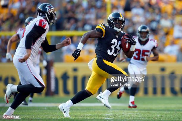 Brandon Dixon of the Pittsburgh Steelers returns a punt 64 yards for a touchdown in the second half against the Atlanta Falcons during a preseason...