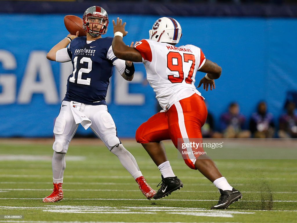 Brandon Doughty #12 from Western Kentucky playing on the West Team looks to throw over Javon Hargrave #97 from South Carolina State playing on the East Team during the first half of the East West Shrine Game at Tropicana Field on January 23, 2016 in St. Petersburg, Florida.