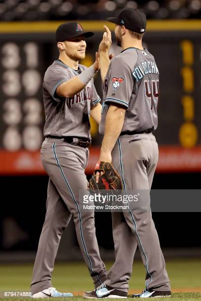 Brandon Drury and Paul Goldschmidt of the Arizona Diamondbacks celebrate their win over the Colorado Rockeis at Coors Field on May 5 2017 in Denver...