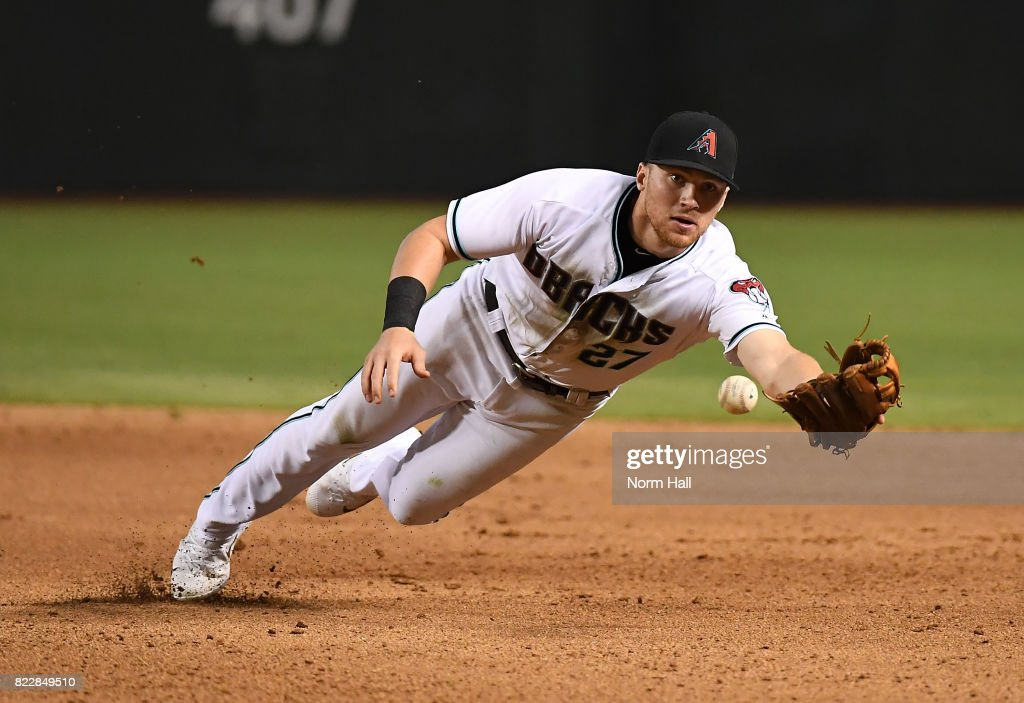 Brandon Drury #27 of the Arizona Diamondbacks attempts to make a diving flip to first base during the ninth inning against the Atlanta Braves at Chase Field on July 25, 2017 in Phoenix, Arizona. Braves won 8-3.